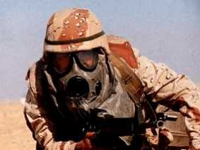 This marine isn't doing so great with his MOPP gear. He has no CPOG. No gloves, probably no overboots. No rubber helmet cover. Its half-hearted training and readiness that kills and gets our men sick