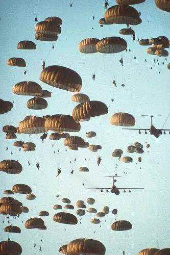 The sky full of armed-to-the-teeth Paratroopers ready to take the fight to the enemy and defeat him.  Paratroopers are trained to take the initiative and think, not sit and wait for someone to tell them what to do, like simplistic marines