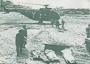 Sikorsky S-55 type helicopter used by the British Commandos in 1956 picks up the dead