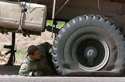 tracks not trucks surviving combat in soft skin vehicles small arms fire and command detonated landmines mis identified as improvised explosive devices or ieds riding around in unarmored hmmwv